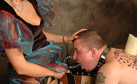 Boytoy sucking her mistress strapon dildo