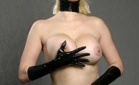 Kinky big boobs whore in her fetish outfit dildoing