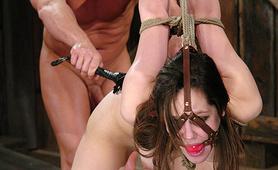 Slave Evan Stone flogging her bound and gagged
