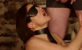 Blindfolded slut on her knees gets pissed by her master