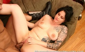 Tattooed milf sucks and fucks monster cock