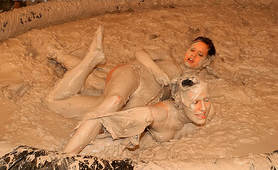 Lesbian babes fighting in the mud