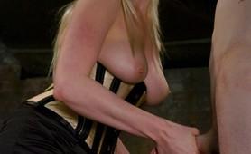 Beautiful blonde dominatrices punishing male slave