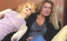 Crazy blonde whore has sex with blow up doll