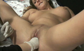 Hot babe having a hand shoved in her pussy