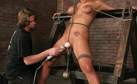 Busty bitch in severe bondage