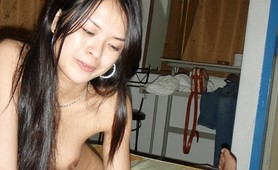 A cute Asian honey gets naked and gives a handjob