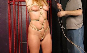 Sexy fetish slave suffers bound caging