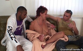 Granny plays with two dicks