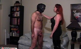 Domina slut kicks masked mans balls