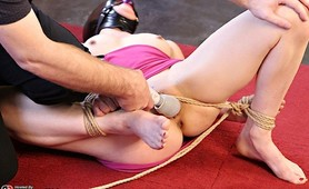 Hogtied Katrina winces in pain and masked