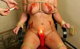 Mistress whips and puts her into fetish pain