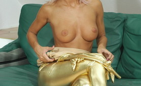 Golden spandex girl with alien eyes