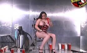 Latex wearing slut pouring wax in her body