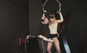 Sexy fetish slave chained and pinched