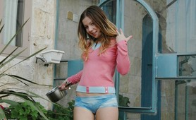Emily posing outside in tight shorts