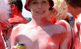 Trashy chicks almost naked during body paint parade