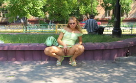 Sexcited blonde slut fingering in public