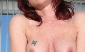 Redhead milf pumping bighardcock in her peach ass