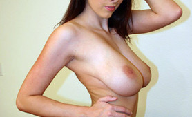 Gianna shows off her huge natural tits