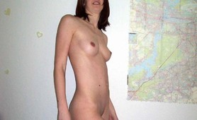 Amateur brunette girl with small tits posing at home