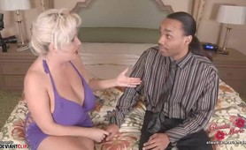 Big tits prostitute Claudia-Marie stares up as she sucks black cock while offering up her soft saggy tits
