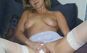 Blonde MILF in stockings plugs her asshole