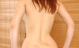 Amateur redhead Annie is wearing pink lace boyshort panties and they look amazing on her already slim and sexy body. She highlights her plump pussy lips by pressing them together and then she strips off her lace panties so we can enjoy a birds eye view of