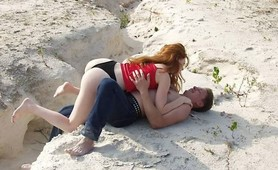 Seductive redheaded babe screwed at the beach