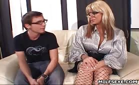 Horny milf shows this boy her oral skills