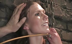 Slave tries to breakfree from her chains inside the dungeon