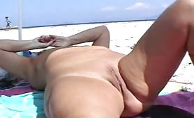 Old slut feeling sexy nude on the beach
