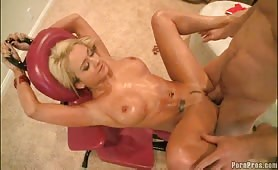 Oiled busty blonde fucked on the massage chair