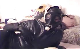 Latex freaks in gas mask fucking
