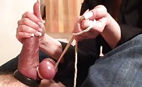Painful cock restrain and handjob