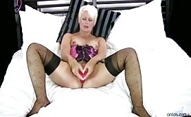 Short blonde haired cougar Sally Taylor is a thick milf with a sensual side that must be seen. Let her lure you into her sexual world by watching her stimulate her honey dripping pussy with a variety of toys!