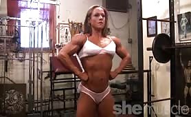 Fit Melissa likes to work out in the gym topless