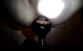 Bailey bottle in a ass